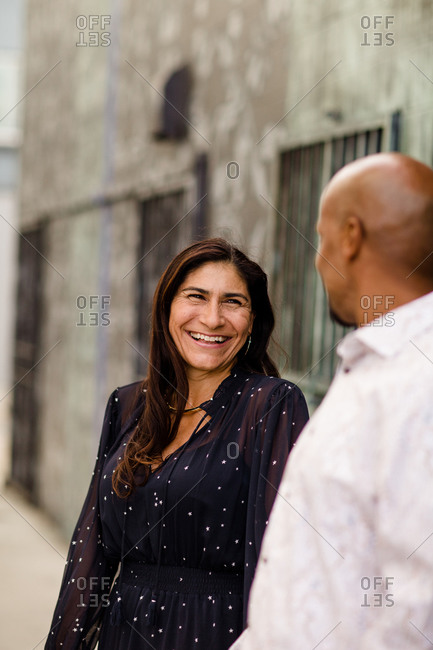 Late Forties Hispanic Woman Laughing in Alley in San Diego