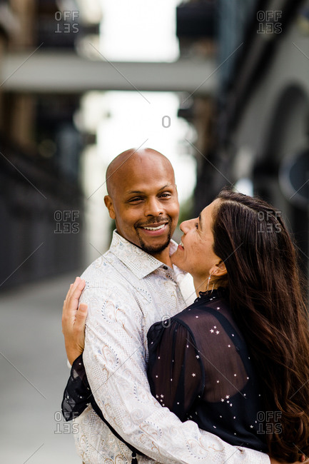 Late Forties Couple Embracing & Smiling in San Diego