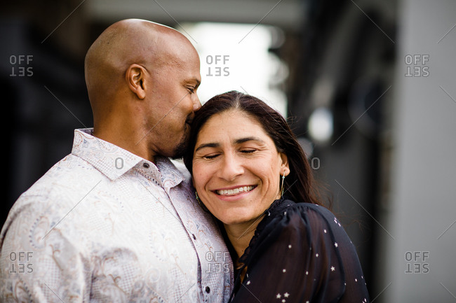 Late Forties Couple Hugging Close Up in San Diego