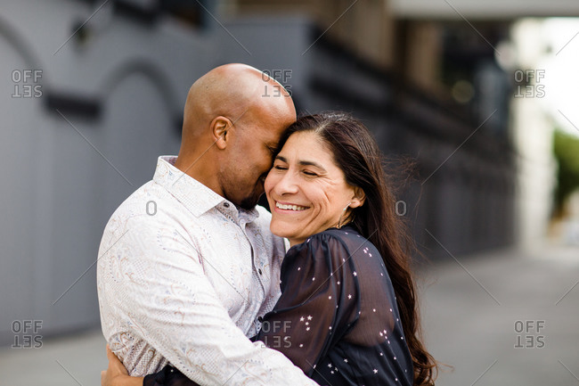 Late Forties Couple Embracing in San Diego