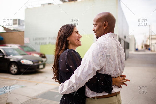 Late Forties Couple Embracing in Alley in San Diego