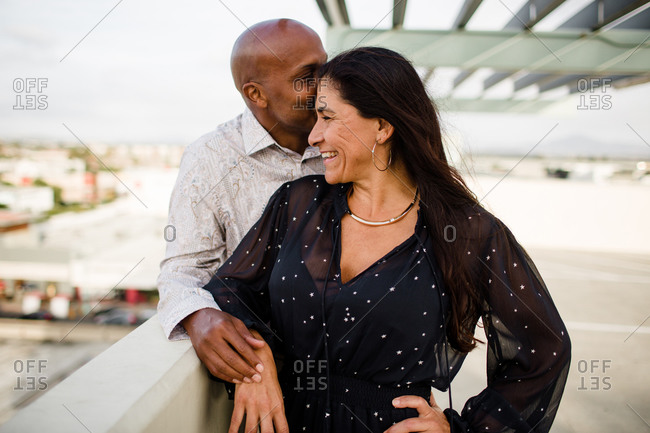 Multiracial Late Forties Couple Embracing at Sunset in San Diego
