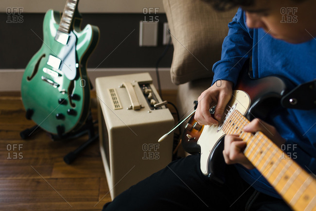 Close up of musician playing electric guitar