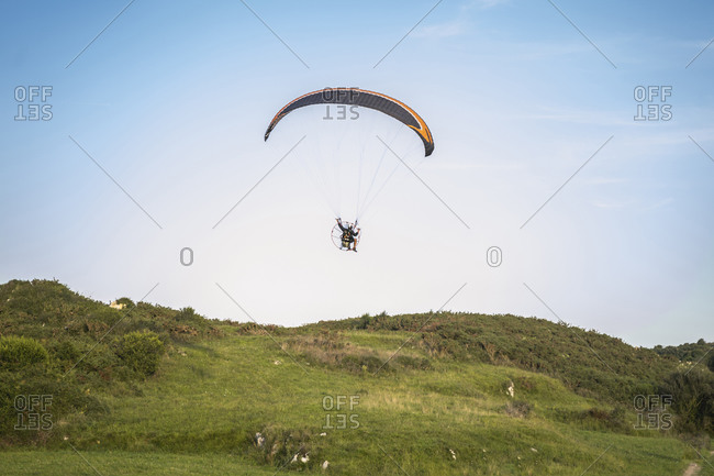 Pilot powered paragliding flying in Asturies