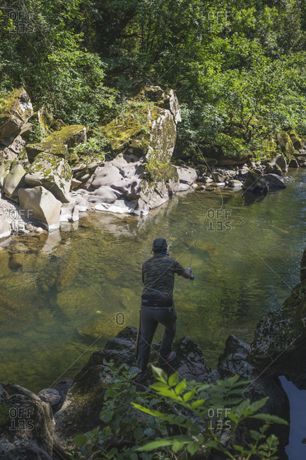 Puente Viesgo, Cantabria, Spain - May 29, 2020: fisherman fishing salmons in north spain