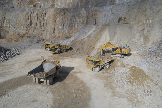 Mining machinery performing operations from an aerial point of view