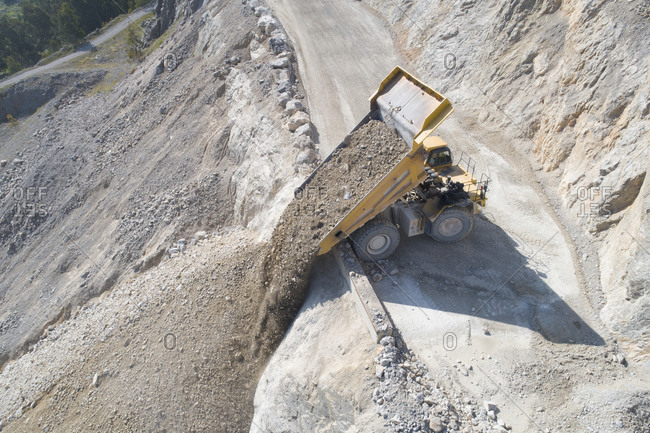 Mining tractor unloading from aerial view