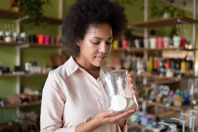 Black small business owner smelling organic soap