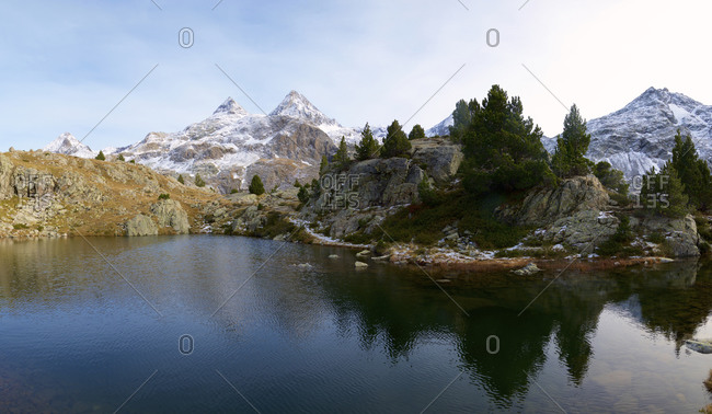 Frogs Lake and snowy peaks in the Pyrenees, Respomuso Valley in Sallent de Gallego, Tena Valley, Huesca Province, Aragon, Spain.