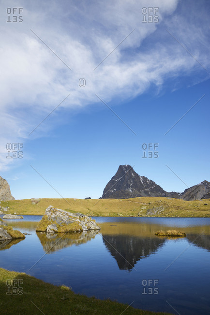 Midi Dossau Peak reflected in Casterau lake. Ayous Lakes area in Ossau Valley, Pyrenees in France.