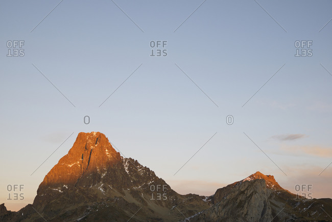 Midi Dossau Peak and Peyreget Peak at sunset in Ossau Valley, Pyrenees