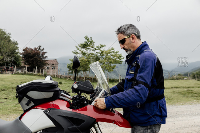 Man preparing his motorcycle before traveling. travel concept