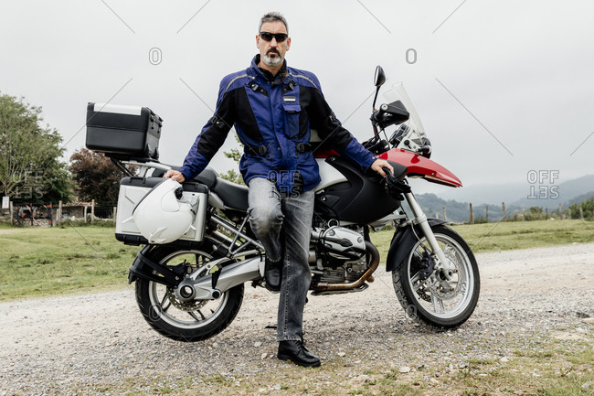 Motorcyclist standing next to his motorcycle. adventure concept