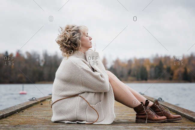 Woman sat outside breathing in the fresh air looking thoughtful