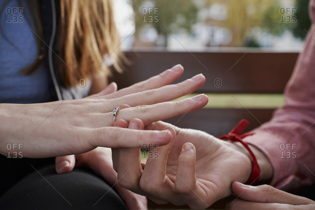 Close-up of a man giving an engagement ring to his girlfriend. Marriage concept