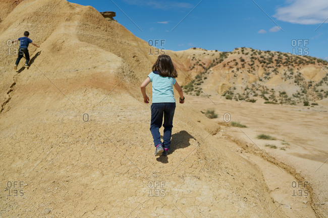 Girl climbing in the Bardenas Reales national park in Navarra, Spain. Travel concept