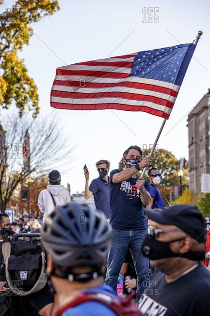 Washington, DC, United States - November 7, 2020: Biden supporters celebrate his win outside the White House on Nov. 7.