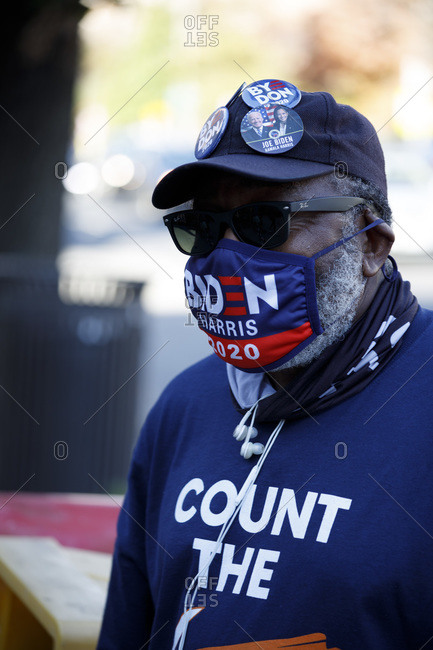 Washington, DC, United States - November 7, 2020: A man sells Biden campaign masks and hat pins after his win on Nov. 7.