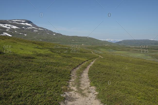 Single track trail of Padjelantaleden Trail though high mountain terrain north of Duottar in Padjelanta national park, Lapland, Sweden