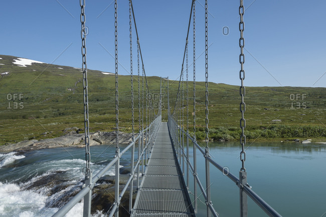 Hanging bridge Mielladno river along Padjelantaleden Trail, Padjelanta national park, Lapland, Sweden