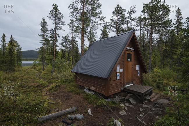 Kvikkjokk, Norrbotten County, Sweden - September 8, 2019: Small shelter along Kungsleden trail to wait for boat ferry to Kvikkjokk, Lapland, Sweden