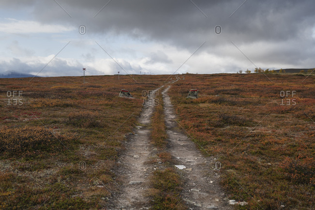 Parallel trails lead thogh high mountain landscape along Kungsleden Trail, Lapland, Sweden