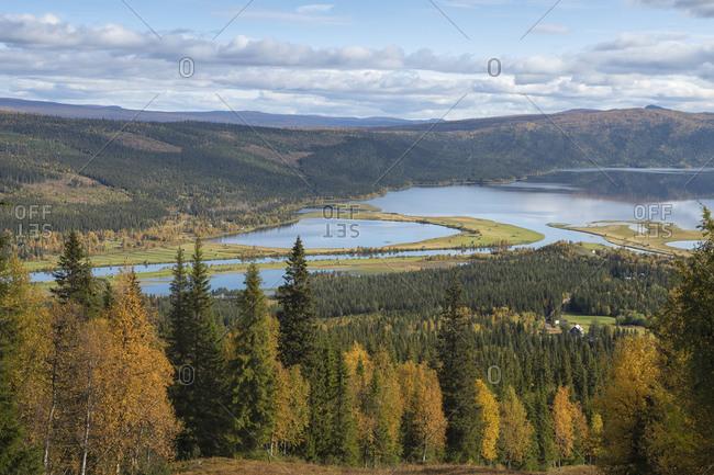 View over lake Gautstrask and surrounding autumn landscape along Kungsleden Trail, Lapland, Sweden