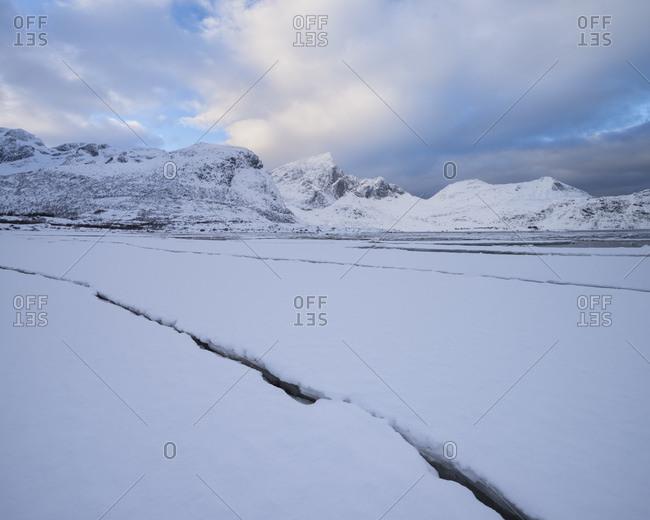 Snow covered tidal sandflats at low tide in Flakstadpollen, Flakstadoy, Lofoten Islands, Norway