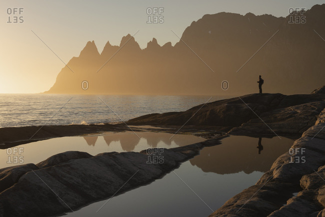 Reflection of person standing at Tungeneset viewpoint, Senja, Norway