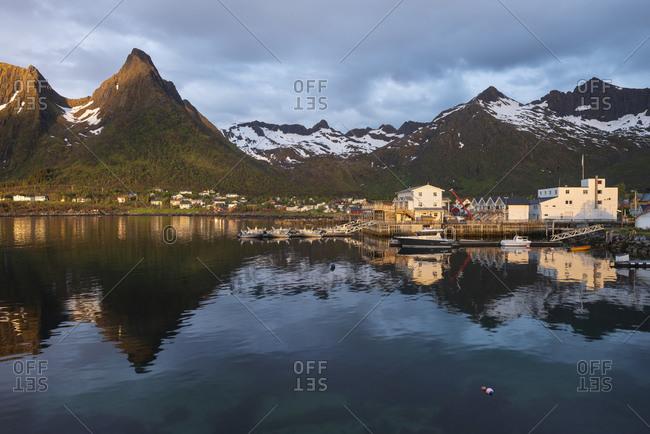 Mefjordvaer, Troms og Finnmark fylke, Norway - June 19, 2017: Pituresque village of Mefjordvaer lit by June midnight sun, Senja, Norway