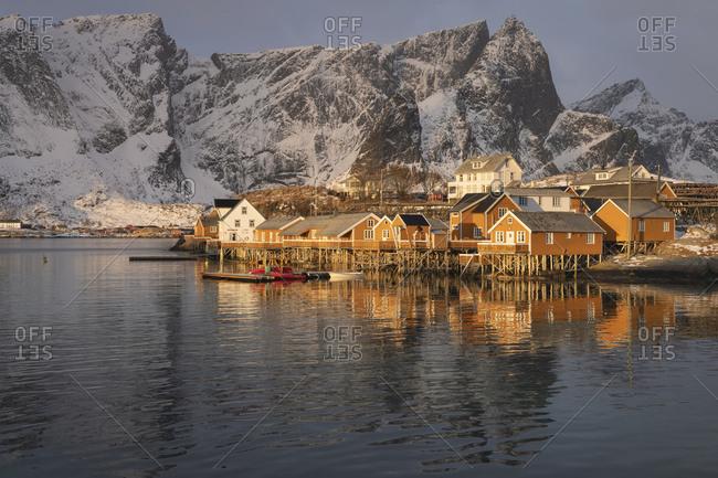 Sunrise light on yellow rorbu cabins at Sakrisoy, Moskenesoy, Lofoten Islands, Norway