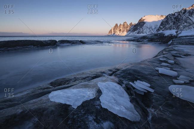Ice on frozen coastal pools at Tungeneset viewpoint, Senja, Norway