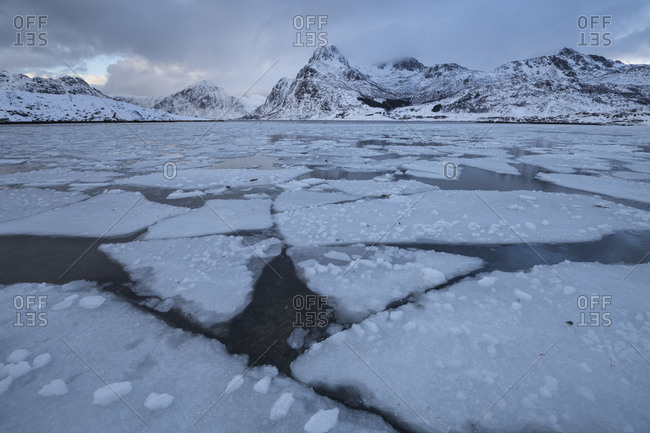 Partially frozen bay at Flakstadpollen, Flakstadoy, Lofoten Islands, Norway