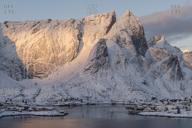 Reine, Nordland, Norway - March 7, 2019: Colorful winter sunrise over mountains over Reine, Moskenesoy, Lofoten Islands, Norway