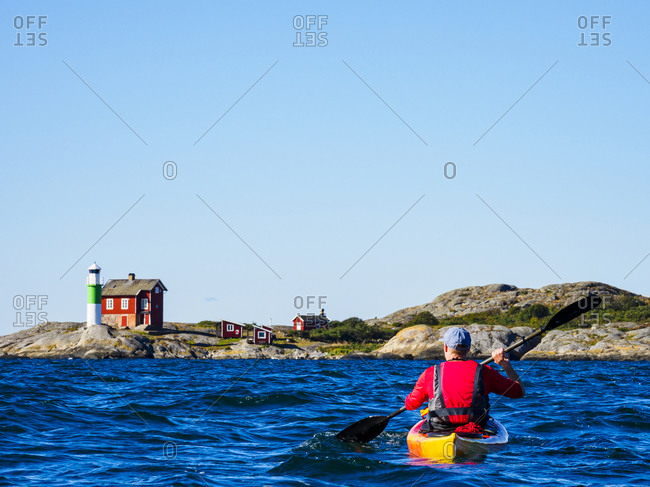Man kayaking on sea from the Offset collection