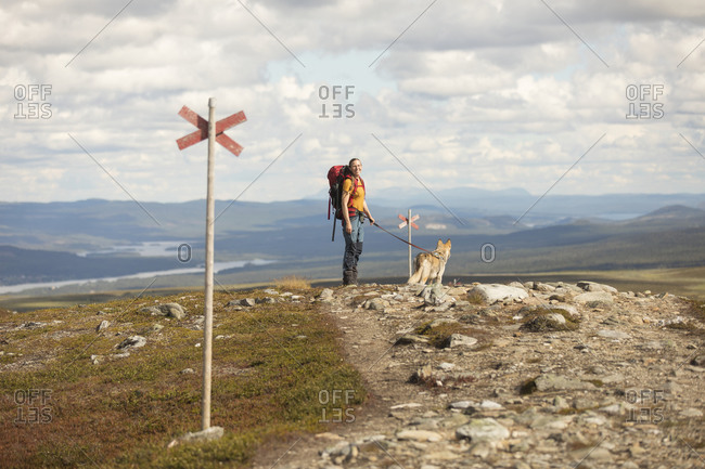 Woman hiking with dog from the Offset collection