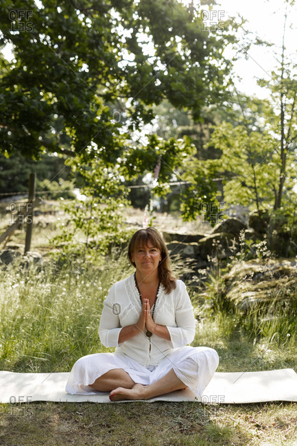 Woman meditating outdoor from the Offset collection