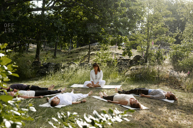 Yoga teacher with students from the Offset collection