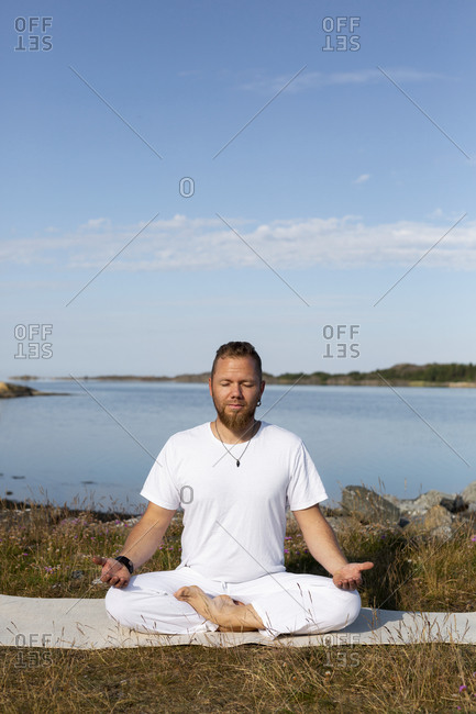 Man meditating at sea from the Offset collection
