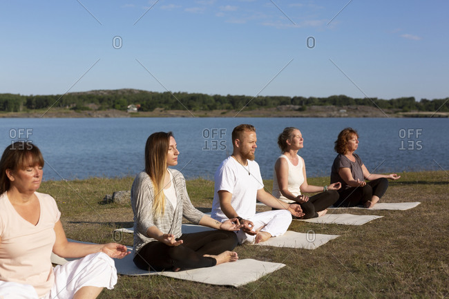 People meditating at sea from the Offset collection