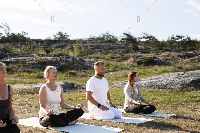 People meditating outdoor from the Offset collection