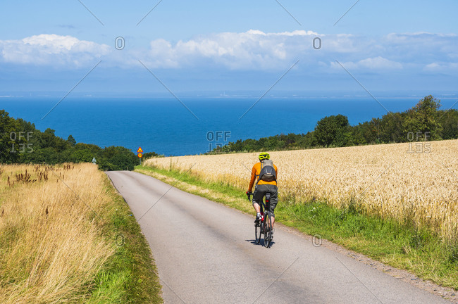 Cyclist on country road from the Offset collection