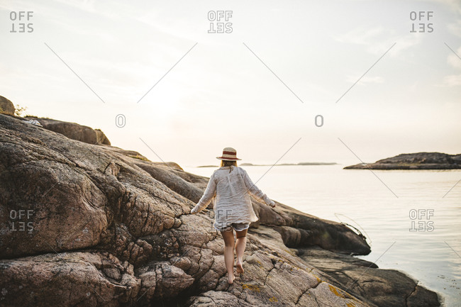 Woman walking at sea from the Offset collection