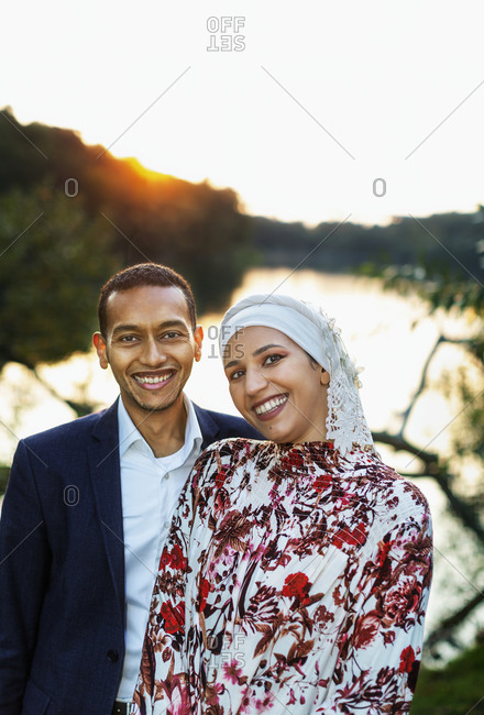 Couple standing at lake from the Offset collection