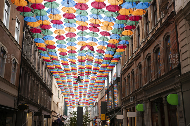 Colorful umbrellas above street from the Offset collection