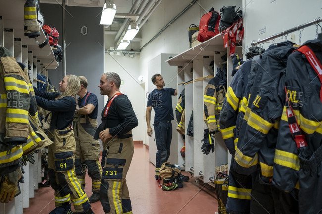 Firefighters changing in locker from the Offset collection