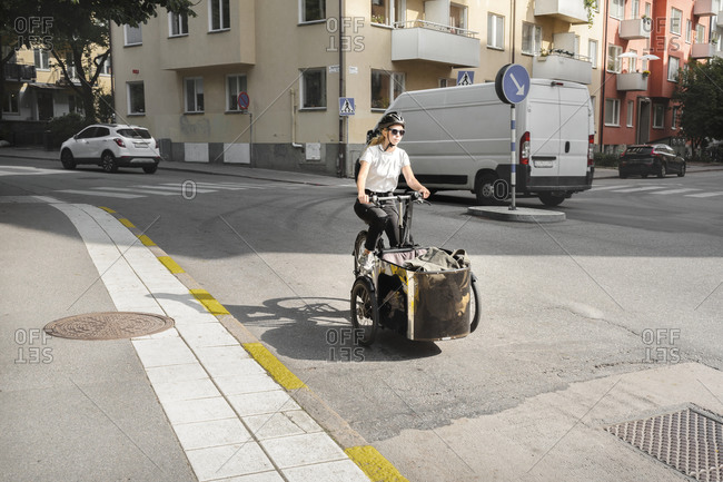 Woman cycling cargo bike from the Offset collection