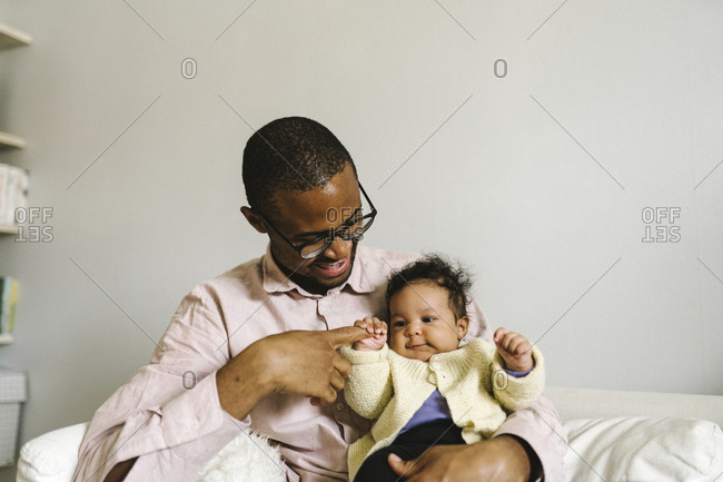 Father with baby daughter from the Offset collection