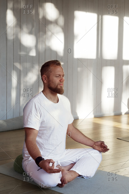 Man practicing yoga in studio
