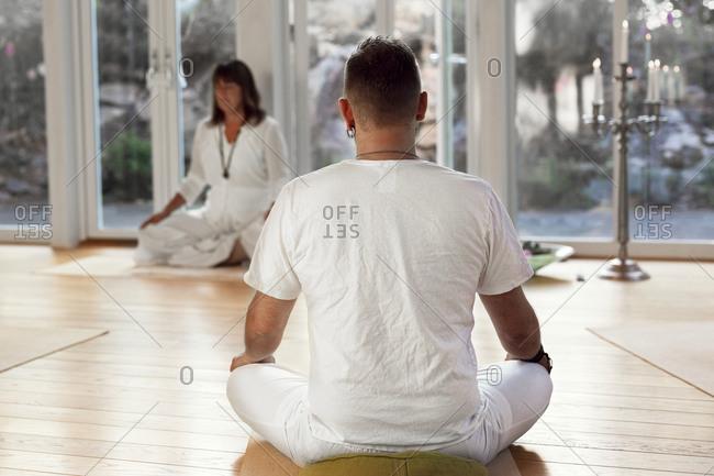 Man practicing yoga in class
